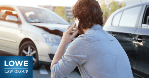 man talking with insurance company after a car crash
